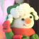[gingerbread house with chirpy snowman outside dressed in red scarf and gloves and green coat and hat]