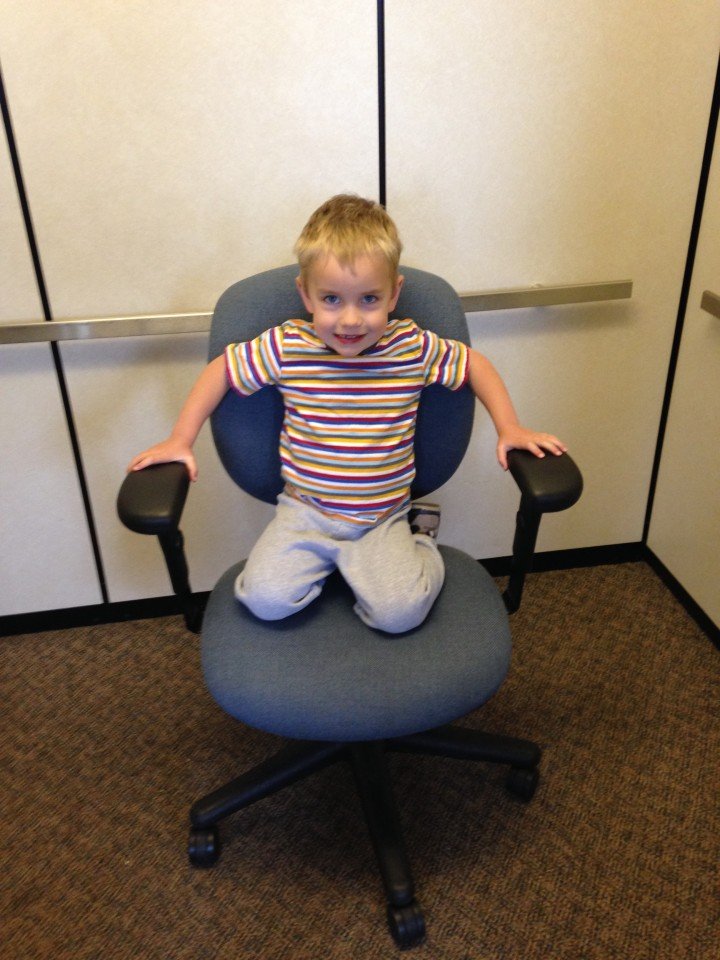 Brayden helps with moving all the office chairs