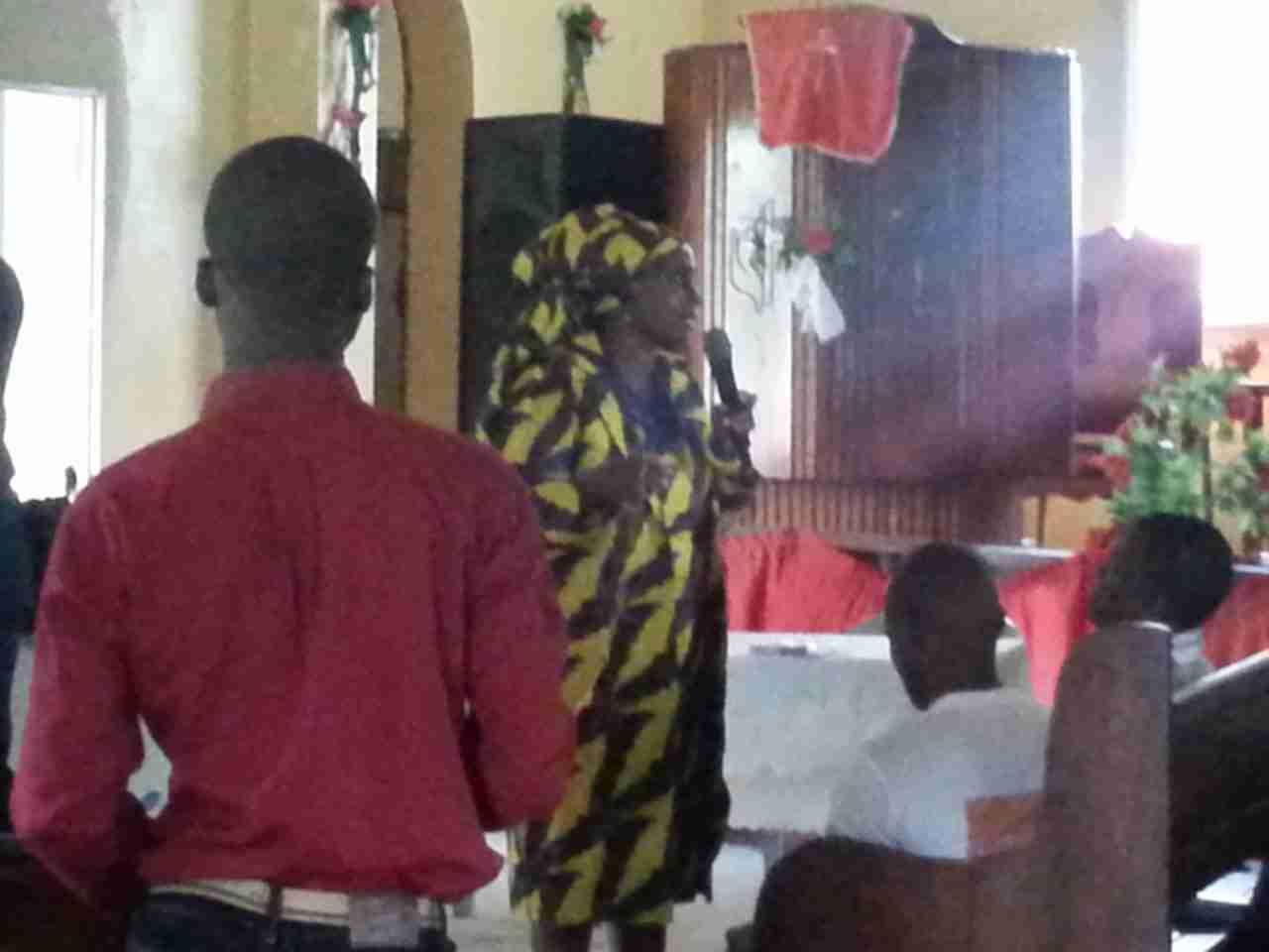 Pastor Grace addressing the people of Gbanga