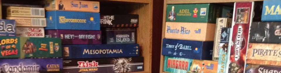 [Stack of board games]