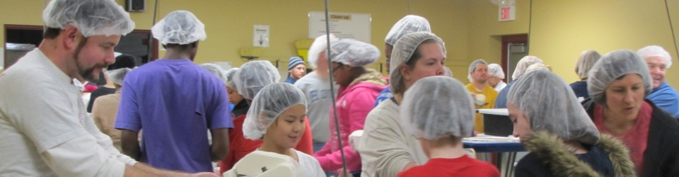 [cumc members at Feed My Starving Children]