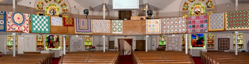 [panorama of quilt display]